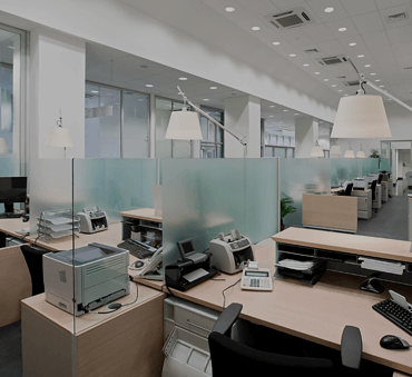 desks in an office with glass dividers