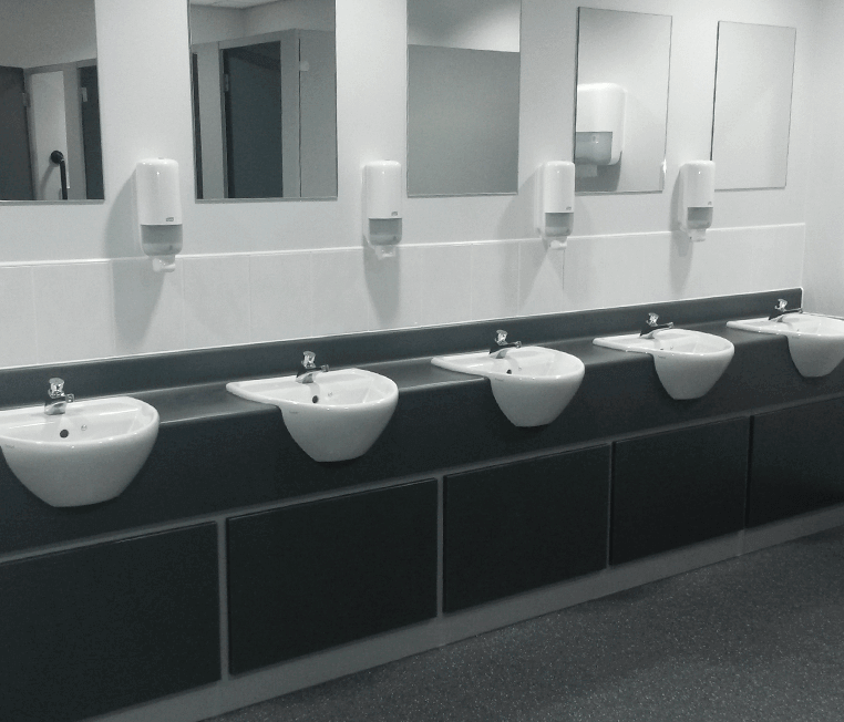 Sinks in a public toilet with mirrors